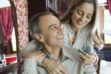 Mature couple  woman admiring new ring
