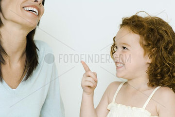 Little girl and mother  laughing