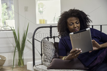 Woman checking e-mail with digital tablet