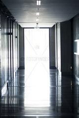 Open door at end of hallway