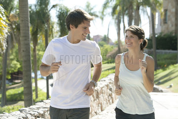Couple jogging together in park