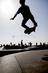 Skateboarder in midair at skate park
