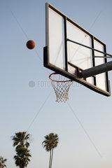 Basketball being thrown toward basketball hoop