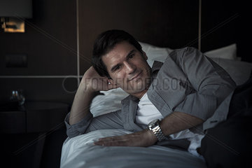 Man relaxing on bed  portrait