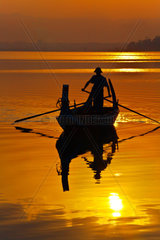 FISHERMAN ply the waters of Taungthaman Lake at sunrise  AMARAPURA  MYANMAR