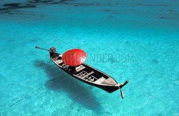 Thailand Phuket Andaman sea Phi Phi Island  boat with red parasol