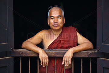 A MONK at the teak BAGAYA KYAUNG MONASTERY which dates back to 1834 in historic INWA which served as the Burmese Kingdoms capitol for 400 years  MYANMAR