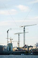 Sweden  Stockholm  construction cranes along water's edge