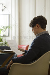 Man reading over employment contract