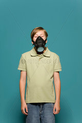 Boy wearing gas mask  eyes closed