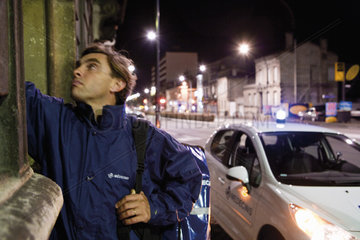Emergency on-call doctor making a house call at night