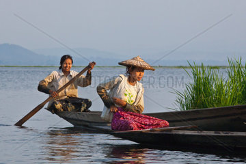 A BURMESE mother with baby uses the teak U BEINS BRIDGE to commute across the Taungthaman Lake  AMARAPURA  MYANMAR
