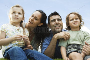 Family sitting together outdoors