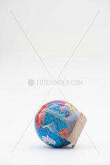 Adhesive bandage wrapped around globe