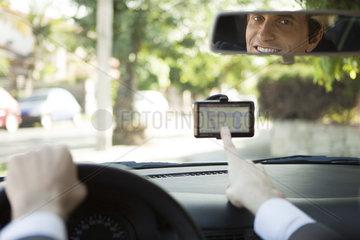 Driver using GPS for navigation assistance