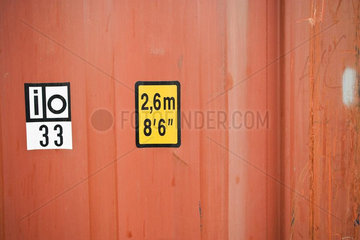 Dimensions marked on side of cargo container  close-up