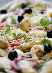 Uncooked toppings on fresh pizza  close-up