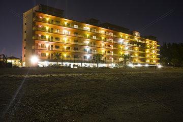 Beachside hotel illuminated at night
