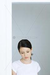 Preteen girl looking down  portrait