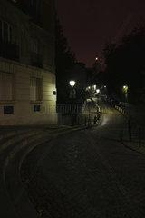 Cobblestone street at night  Montmartre  Paris  France