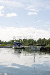 Boats docked near lake pier