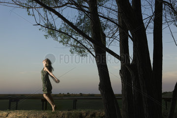 Woman on tiptoes  arms out  jumping