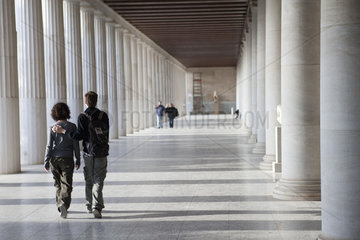 Tourists walking thorugh the Stoa of Attalos in the Ancient Agora  Athens  Greece