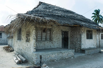 Tanzania  Zanzibar  house made of stone with thatched roof