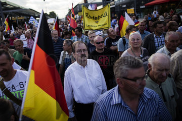 PEGIDA supporters attend weekly rally