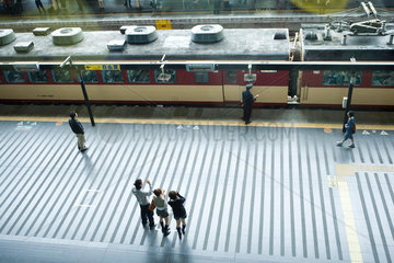 People standing on train platform  waving  high angle view