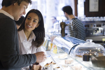 Couple talking together in cafe