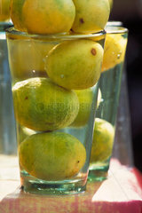 Lemons soaking in glass of water