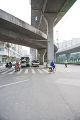 Bike and car traffic under overpasses