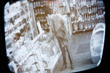 Customer browsing in convenience store  image captured by surveillance camera