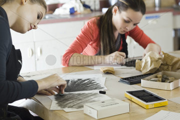 Young artists drawing with charcoal