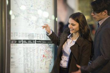 Couple looking at subway map