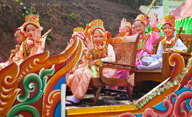Girls in costume are part of a PROCESSION for young men entering a Buddhist monastery in KENGTUNG also known as KYAINGTONG  MYANMAR