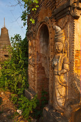 Stucco BUDDHIST DEITIES at NYAUNG OHAK located at INDEIN consisting of ancient SHRINES  INLE LAKE  MYANMAR