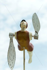 Wooden whirligig carved in the shape of swimmer