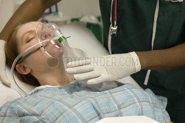 Patient receiving oxygen treatment