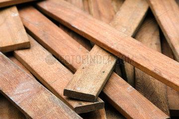 Pile of weathered wood planks