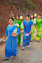 PROCESSION carrying houshold items for young men entering a Buddhist monastery in KENGTUNG also known as KYAINGTONG  MYANMAR