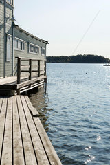 Pier and boathouse on lake