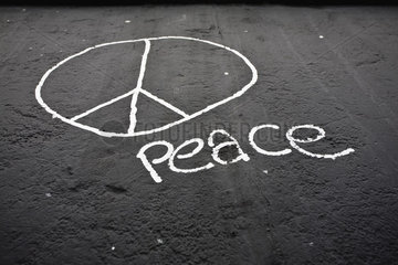 Peace sign and the word peace painted on the Berlin Wall  Berlin  Germany