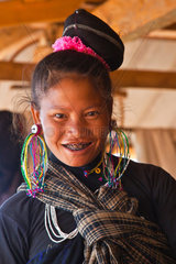 A ANN TRIBAL woman in traditional dress in her village near KENGTUNG also known as KYAINGTONG  MYANMAR