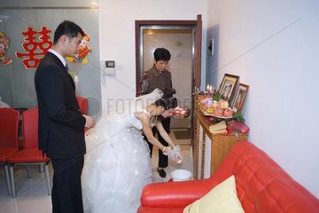 Chinese wedding  bride taking offering to ancestral shrine