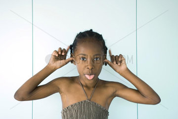 Girl sticking out tongue  looking at camera  portrait