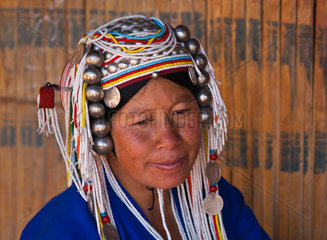 Women of the AKHA tribe wear elaborate headdresses made of beads  silver coins and hand loomed cotton  village near KENGTUNG or KYAINGTONG  MYANMAR