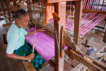 The weaving of LOTUS SILK fabric from the stalks of the lotus plant is a local industry of INLE LAKE  MYANMAR