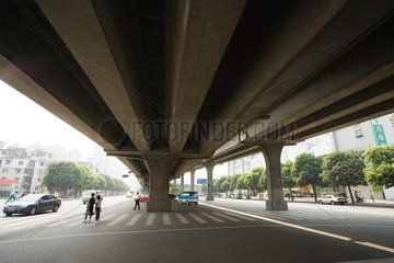 Pedestrian crossing under overpass  low angle view